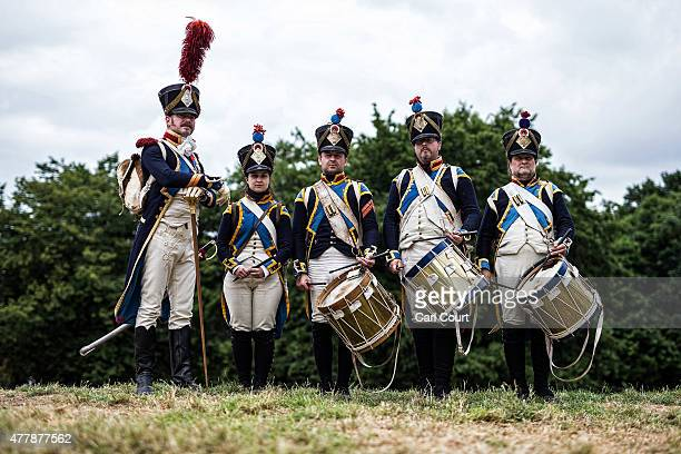 Historical reenactors from the Czech Republic pose for a photograph in their role as a French military band ahead of the second part of a large scale...