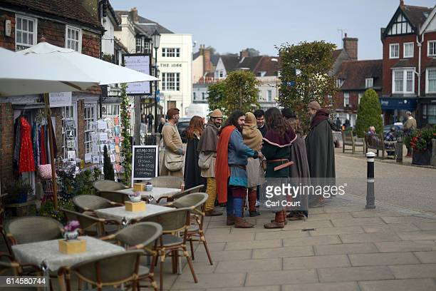 Historical reenactors gather next to a cafe ahead of a reenactment of the Battle of Hastings on October 14 2016 in Battle England Reenactors have...