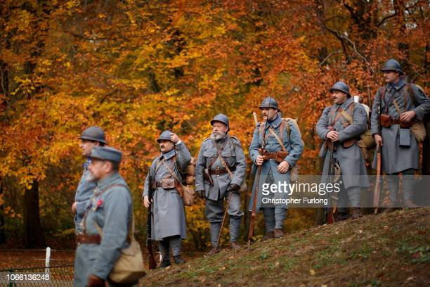 Historical reenactors gather to pay their respects in the clearing of Rethondes on November 11 2018 in Compiegne France The armistice ending the...