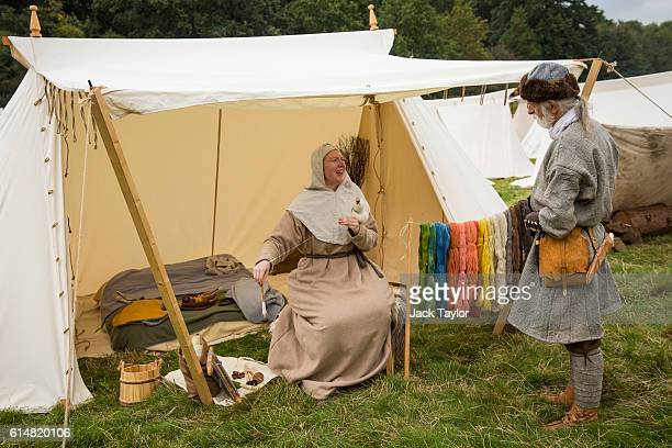 Historical reenactors in the Norman Camp chat as they prepare to take part in a reenactment of the Battle of Hastings on October 15 2016 in Battle...