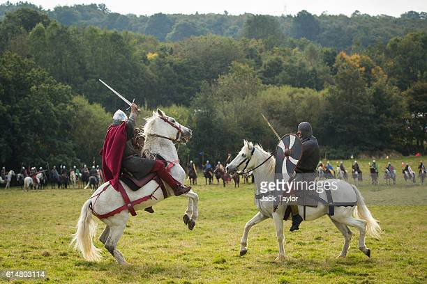 Historical reenactors on horseback take part in a demonstration ahead of a reenactment of the Battle of Hastings on October 15 2016 in Battle England...