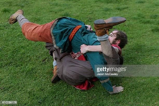 Historical re-enactors particpate in Glima, the martial arts of the Vikings during the Medieval Faire at St Ives Showgrounds on September 25, 2016 in...