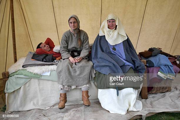 Historical reenactors pose for a photograph ahead of a reenactment of the Battle of Hastings on October 14 2016 in Battle England Reenactors have...