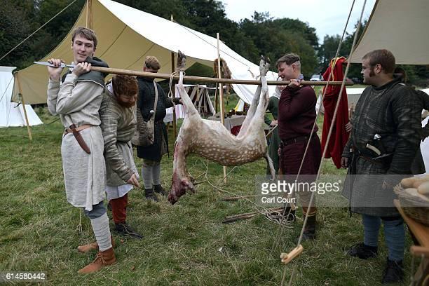 Historical reenactors prepare to cook a deer ahead of a reenactment of the Battle of Hastings on October 14 2016 in Battle England Reenactors have...