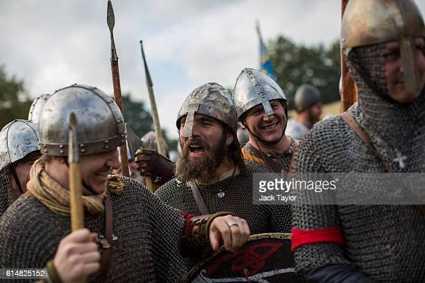 Historical reenactors prepare to take part in a reenactment of the Battle of Hastings on October 15 2016 in Battle England Reenactors have gathered...