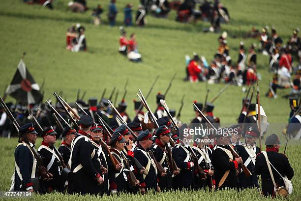 Historical reenactors prepare to take part in the first part of a large scale reenactment of the battle of Waterloo to mark it's bicentenary on June...