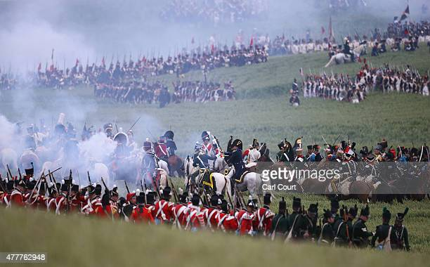 Historical reenactors take part in the first part of a large scale reenactment of the battle of Waterloo to mark it's bicentenary on June 19 2015 in...