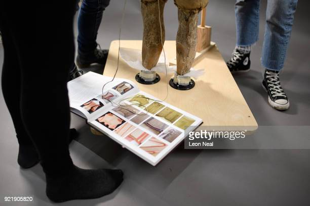 A historical reference book lays open as members of the conservation team fit a 'pair of straight bodies' to the funeral effigy of Elizabeth I at...