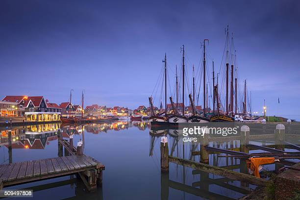 historical sailing boats in the harbour of Volendam
