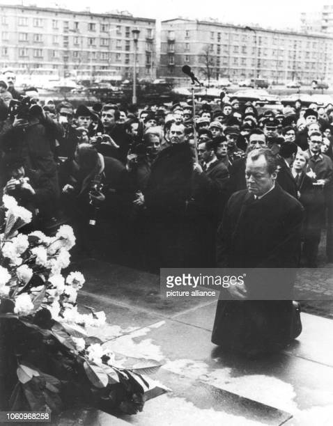 German chancellor Willy Btrandt knees in front of the monument in the former Jewish ghetto of Warsaw on the 7th of December in 1970 which is...
