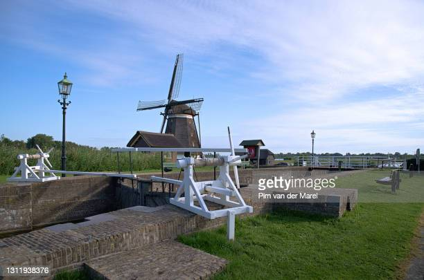 historical sluice - netherlands stock pictures, royalty-free photos & images
