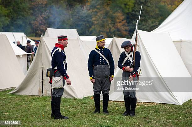 Historical society enthusiasts from Germany in the role of Prussian line infantry prepare to commemorate the 200th anniversary of The Battle of...