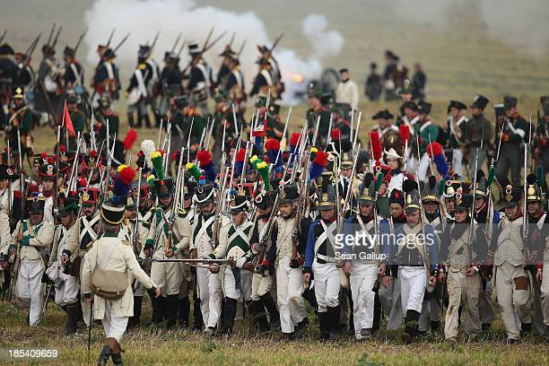 Historical society enthusiasts in the role of French infantry troops fighting for Napoleon retreat during the re-enactment of The Battle of Nations...