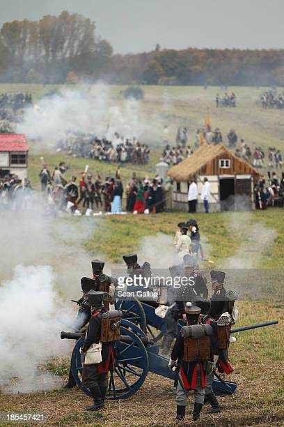 Historical society enthusiasts in the role of Prussian artillery units fighting Napoleon advance during the reenactment of The Battle of Nations on...