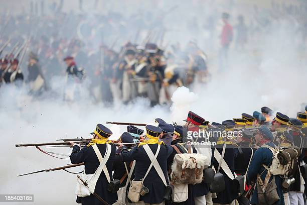 Historical society enthusiasts in the role of Prussian soldiers fire against troops loyal to Napoleon during the reenactment of The Battle of Nations...