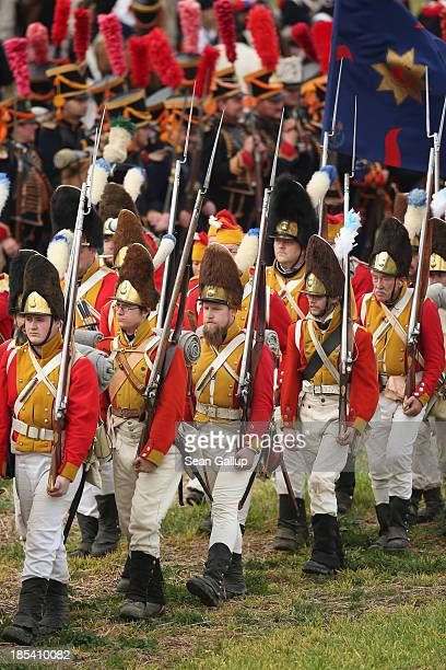 Historical society enthusiasts in the role of Saxon and other troops loyal to Napoleon prepare to advance against the enemy during the reenactment of...