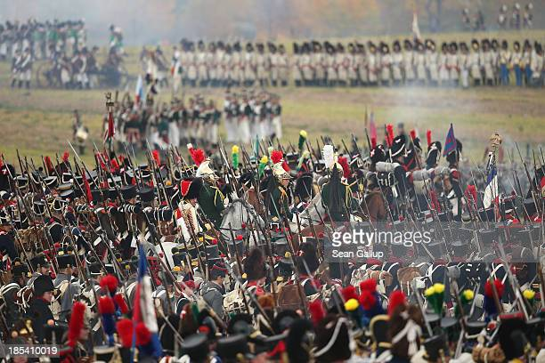 Historical society enthusiasts in the role of troops loyal to Napoleon advance against the enemy during the reenactment of The Battle of Nations on...