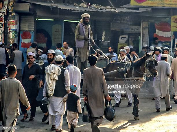 CONTENT] Historical street scene in Peshawar Pakistan showing typical daily life and activity
