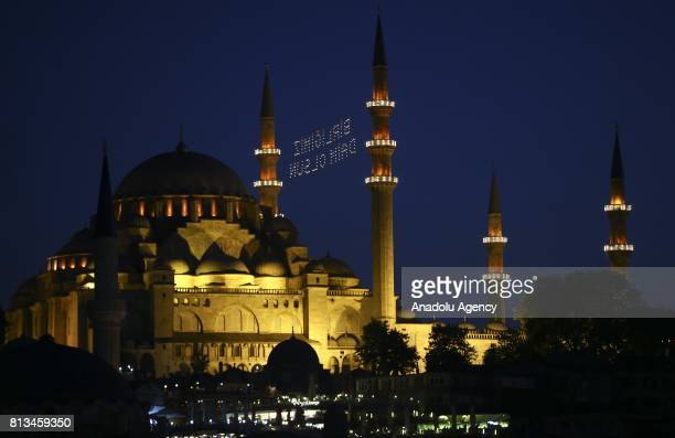 Historical Suleymaniye Mosque is seen with a Mahya reading in Turkish May our nation's unity last forever within the events of July 15 Democracy and...