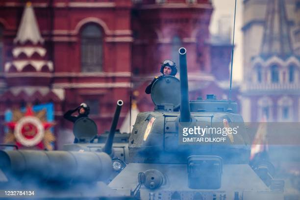 Historical T-34 tanks move through Red Square during the Victory Day military parade in Moscow on May 9, 2021. - Russia celebrates the 76th...