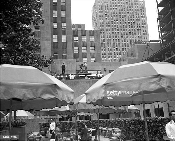 Television Mobile Units Pictured NBC cameraman on top of the telemobile units during the first tests over the new coaxial cable that linked the...