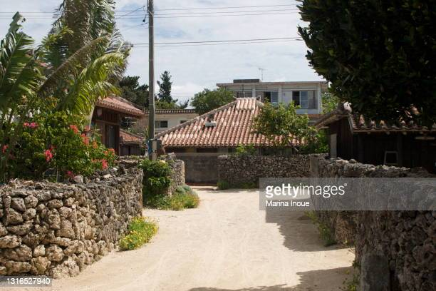 historical village of taketomi island in okinawa, japan - 日本建築 ストックフォトと画像