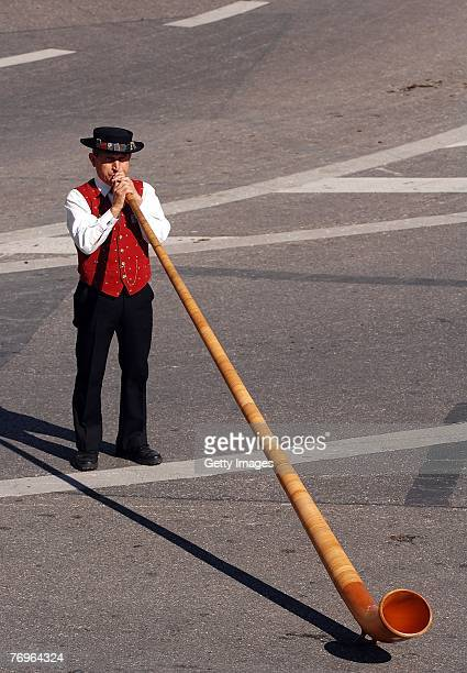 A historically dressed man playing an alphorn at the Costume and Riflemen's Parade on September 2007 in Munich Germany The costume and riflemen's...