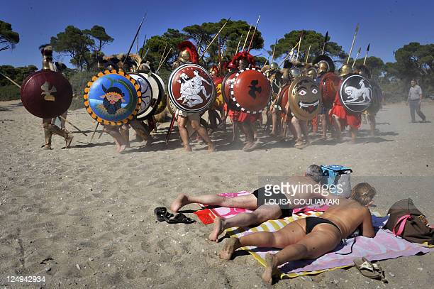 History brought to life in Battle of Marathon reenactment Sunbathers watch Italian reenactors dressed as Greek hoplites march to perform the 490 BC...