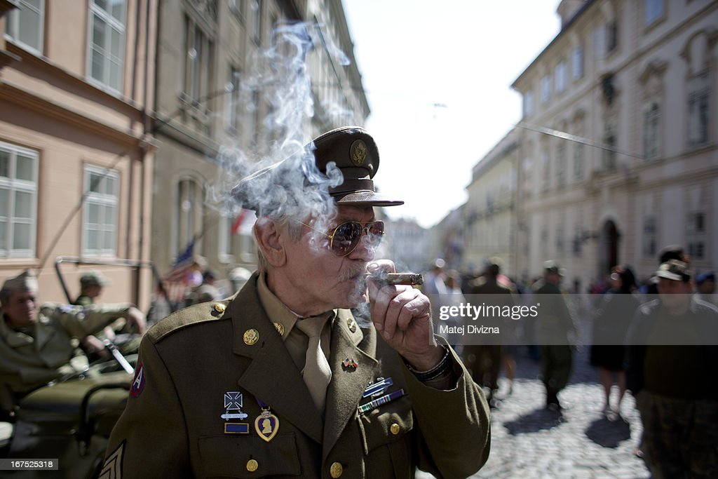 A history enthusiast dressed in WWII US army uniform smokes his cheroot during the ''Convoy of Liberty'' event on April 26, 2013 in Prague, Czech Republic. 'Convoy of Liberty' commemorates when in 1945 the western part of the Czech Republic was liberated by the US Army from Nazi oppression. The convoy's route begins in Prague tomorrow and makes its first stop in front of the US Embassy, where it will be met by the Czech Army Military Band.