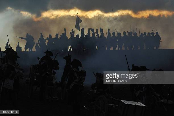 History enthusiasts dressed as soldiers take part in a reenactment of Napoleon's 1805 Battle of Austerlitz near the South Moravian city of Slavkov on...