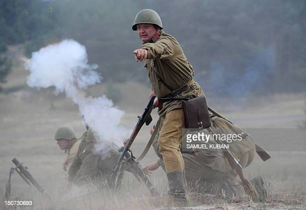 History enthusiasts dressed as Soviet soldiers and Nazi soldiers reenact 'Berl'n 1945 Seelow' on August 25 2012 during the biggest international...