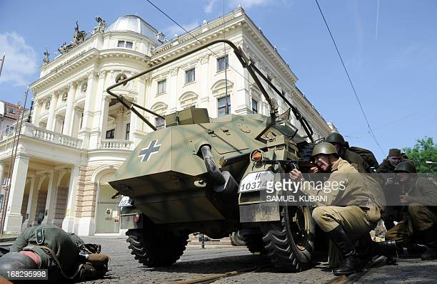 History enthusiasts dressed as Soviet soldiers and Nazi soldiers reenact the liberation of Bratislava on May 8 2013 during the commemoration of the...