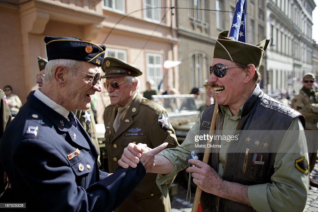 History enthusiasts dressed in WWII US army uniform greet to each other during the ''Convoy of Liberty'' event on April 26, 2013 in Prague, Czech Republic. 'Convoy of Liberty' commemorates when in 1945 the western part of the Czech Republic was liberated by the US Army from Nazi oppression. The convoy's route begins in Prague tomorrow and makes its first stop in front of the US Embassy, where it will be met by the Czech Army Military Band.
