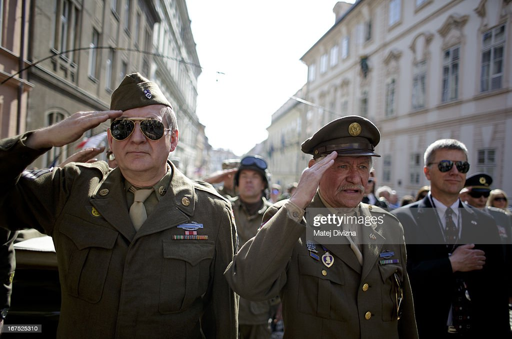 History enthusiasts dressed in WWII US army uniform salute during athem of the USA during the ''Convoy of Liberty'' event on April 26, 2013 in Prague, Czech Republic. 'Convoy of Liberty' commemorates when in 1945 the western part of the Czech Republic was liberated by the US Army from Nazi oppression. The convoy's route begins in Prague tomorrow and makes its first stop in front of the US Embassy, where it will be met by the Czech Army Military Band.