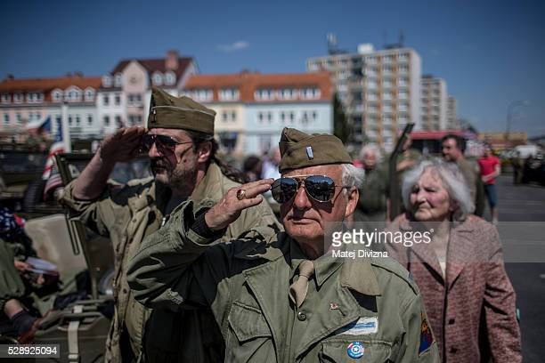 History enthusiasts dressed in WWII US Army uniform salute during the anthem of the Czech Republic during stop over the 'Convoy of Liberty' event...