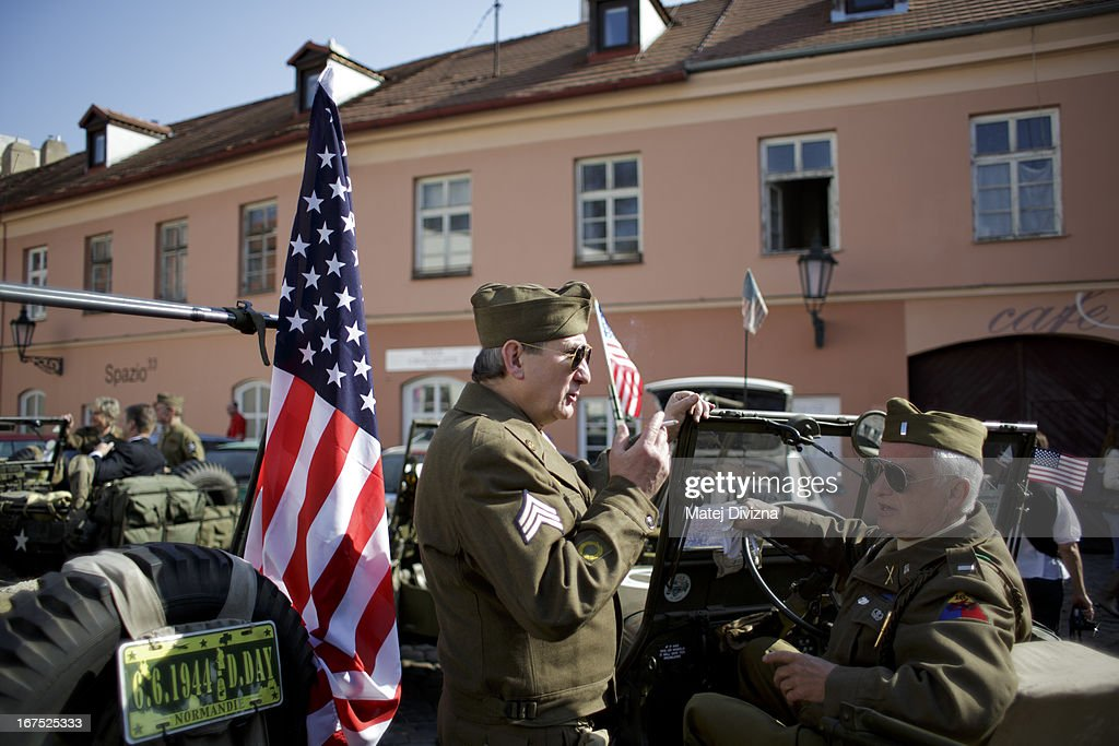 History enthusiasts dressed in WWII US army uniform talk to each other during the ''Convoy of Liberty'' event on April 26, 2013 in Prague, Czech Republic. 'Convoy of Liberty' commemorates when in 1945 the western part of the Czech Republic was liberated by the US Army from Nazi oppression. The convoy's route begins in Prague tomorrow and makes its first stop in front of the US Embassy, where it will be met by the Czech Army Military Band.