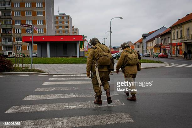 History enthusiasts dressed in WWII US Army uniform walk through the city during stop over the 'Convoy of Liberation' event which drive through west...
