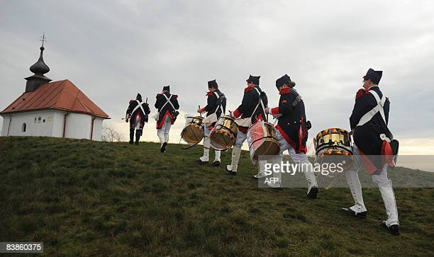 History enthusiasts of Belgium dressed as soldiers of French army march to a hill after the reenactment of Napoleon I's 1805 Battle of Austerlitz...