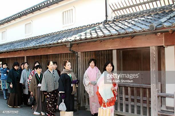 History fans wearing kimono stroll the old town on February 23 2013 in Hagi Yamaguchi Japan