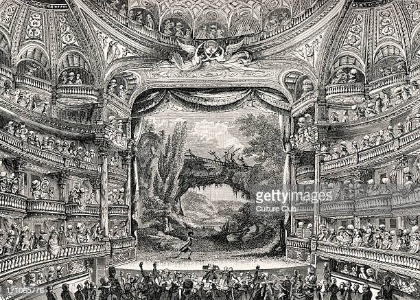 The Variétés Amusantes theatre in Paris 1789 Grand interior fashionable gentlemen and ladies in audience Orchestra in pit Tiers of boxes 18th century...