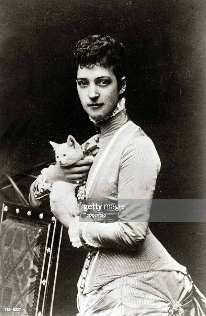 History Personalities. British Royalty. pic: 1870. Alexandra,Princess of Wales, (who married Edward, Prince of Wales in 1863), pictured with a pet cat. Queen Alexandra, (1844-1925)in her early days a Danish Princess, later Queen Consort to King Edward VII : News Photo