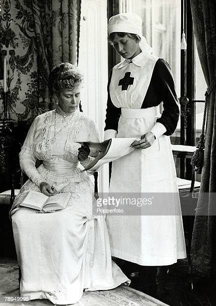 History Personalities, British Royalty, pic: 1918, HM,Queen Mary pictured with her daughter Princess Mary, the Princess Royal, who is dressed in Red...