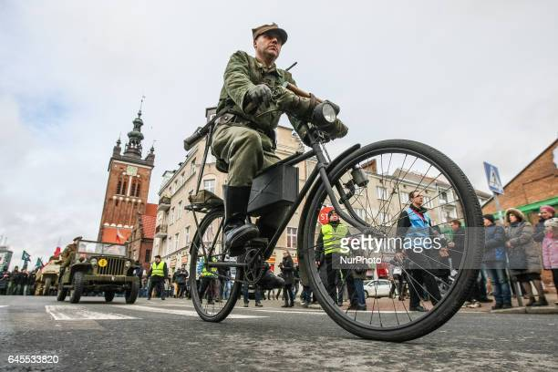 History reenactors dressed as Cursed soldiers are seen during the Cursed soldiers Day parade on 26 February 2017 in Gdansk Poland The Cursed soldiers...