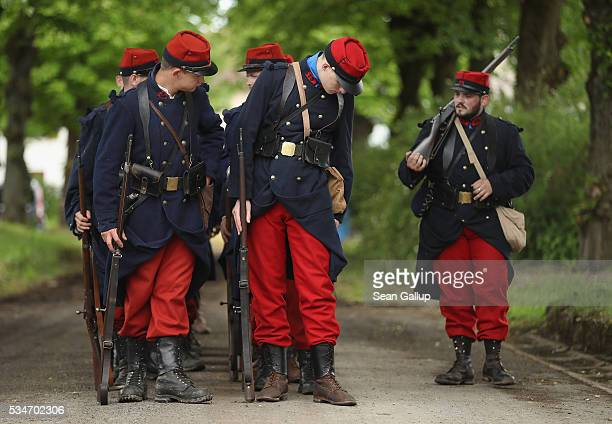 History reenactors wearing World War I French military uniforms prepare to participate in a parade on May 27 2016 in Verdun France The governments of...