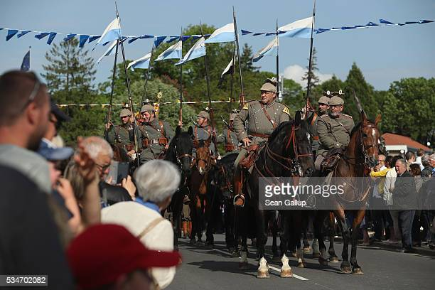 History reenactors wearing World War I German military uniforms and on horseback take part in a parade on May 27 2016 in Verdun France The...