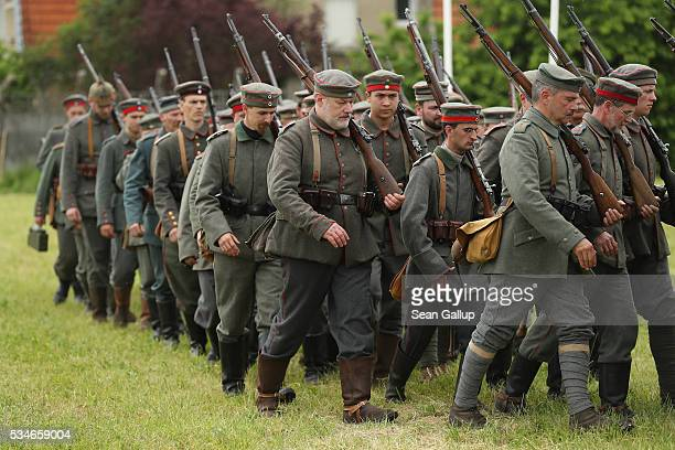 History reenactors wearing World War I German military uniforms march at their campsite prior to a parade on May 27 2016 in Verdun France The...