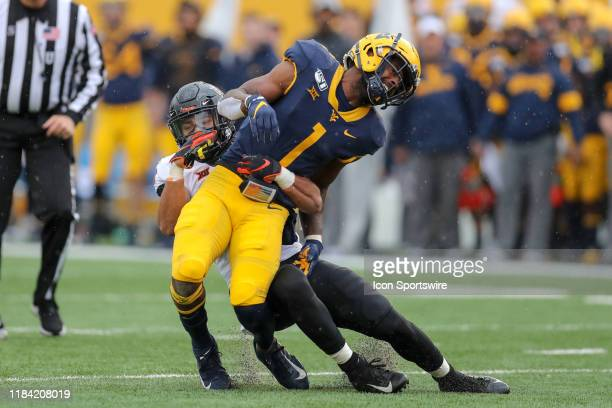 A hit by Oklahoma State Cowboys linebacker Amen Ogbongbemiga breaks up a pass intended for West Virginia Mountaineers wide receiver TJ Simmons during...