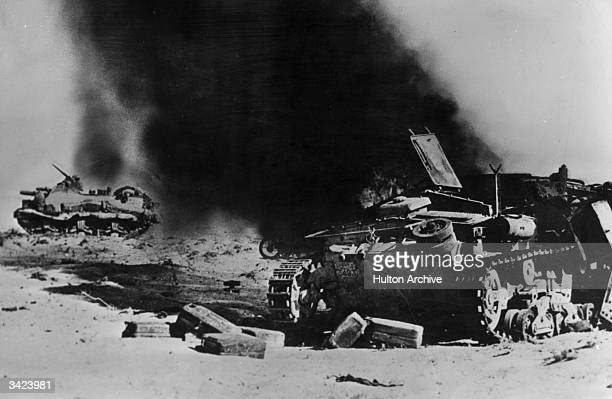 Hit by the 105mm howitzer of a US tank destroyer in North Africa the heavy German tank is destroyed by flames US 'tank busters' of this type have...