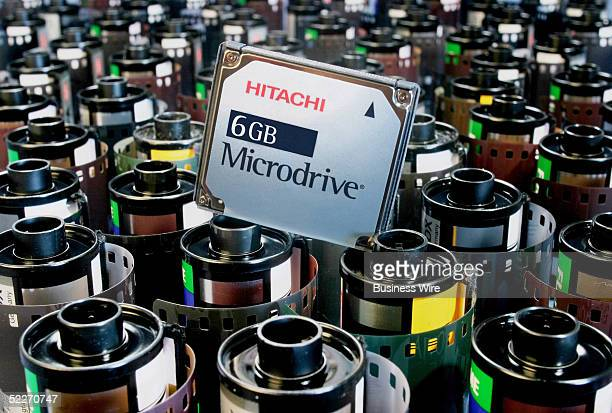 Hitachi 6 gigabyte one-inch Microdrive digital media holds 1,500 to 3,000 songs or 8 hours of MPEG-4 video, with new reduced retail price of $299 USD.