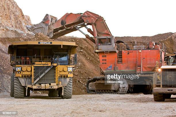 A Hitachi excavator is used to load earth into a Caterpillar Inc mining truck at the AngloGold Ashanti Ltd Cripple Creek Victor gold mine in...